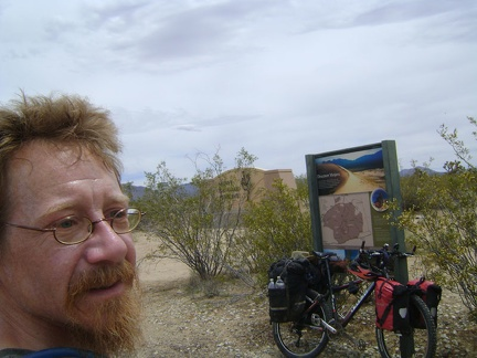 The bottom of Cima Road exits Mojave National Preserve; I take a break by the monument that folks see upon entering the Preserve