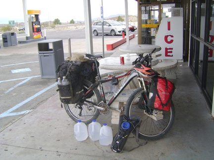 I buy three gallons of water at the Valley Wells gas station store at I-15 and take a nice long break