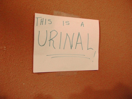 "The Valley Wells urinal is so unique that an adjacent handwritten sign tells you that, ""yes, this IS a urinal!"""