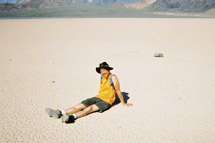 I sit down on The Racetrack playa, like I might do at any other beach