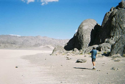 "Phil stands on ""the beach"" at The Grandstand, in the middle of The Racetrack playa"