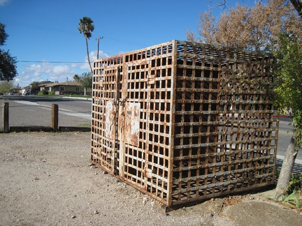 Outside the Mojave River Museum in Barstow is an old exterior cage-style jail cell