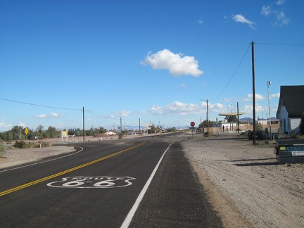 Route 66 reaches a stop sign as it passes through the little town of Daggett, California