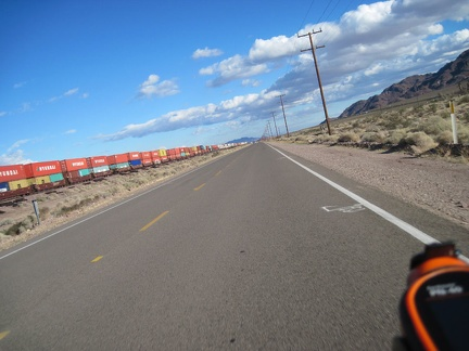 Riding east on Route 66 away from Daggett, one of many long freight trains passes by