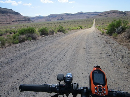 I start riding the lower part of Wild Horse Canyon Road and will park just before those hills almost two miles ahead