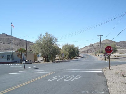 The stop sign in Tecopa Hot Springs village, looking back toward Baker