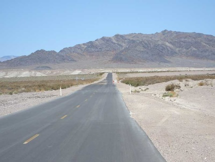 Just past Grimshaw Dry Lake, Tecopa Hot Springs Road heads straight toward the mountains