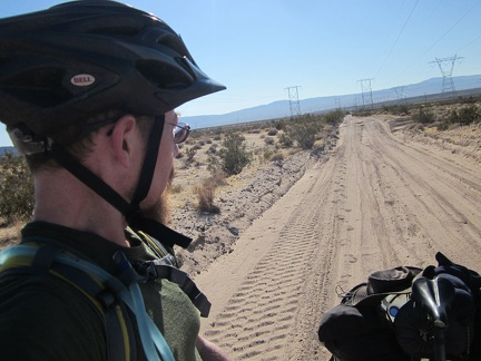 I pause on the way up the gentle hill leading into the Cady Mountains to look back on the sandy road