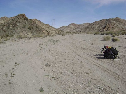 Hike-a-biking through sand on the way up Jackass Canyon Road