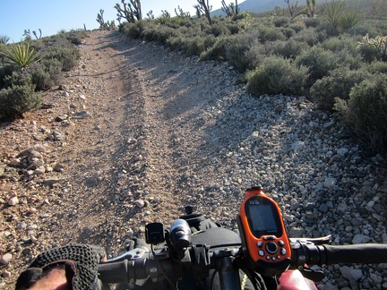 Loose rock and an uphill grade require that I walk the 10-ton bike up parts of the road toward the Pine Spring area