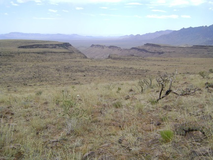 Looking southwest across Wild Horse Mesa, the plateau drops off into the southern end of Beecher Canyon